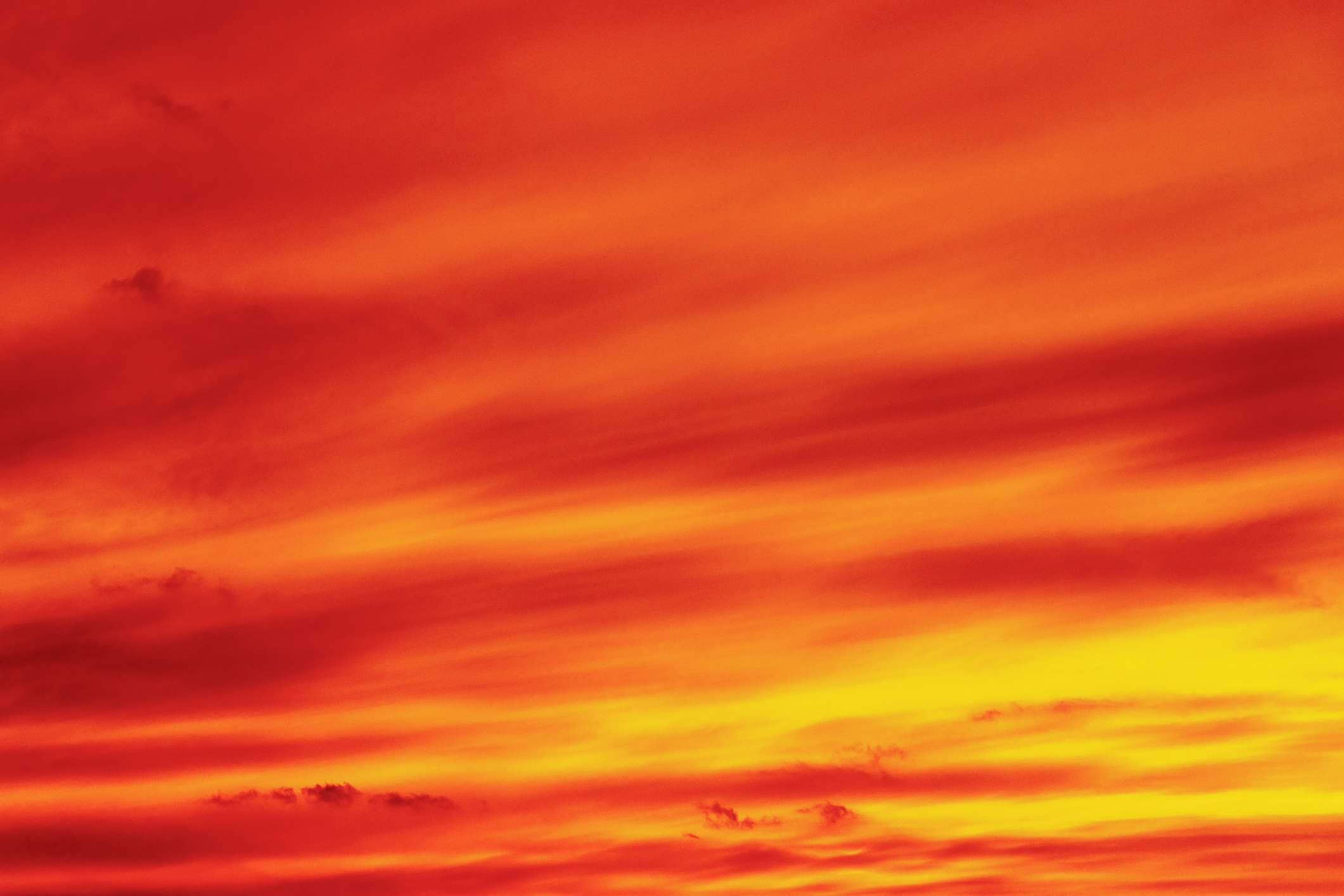 sky is colored deep red, orange, and yellow creating warm and vitalizing atmosphere.
