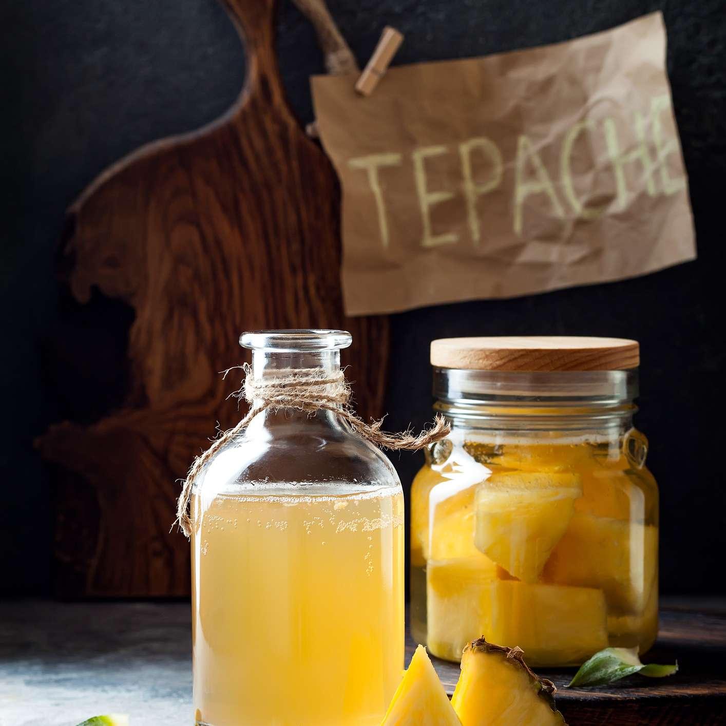 A display of jarred pineapple tepache