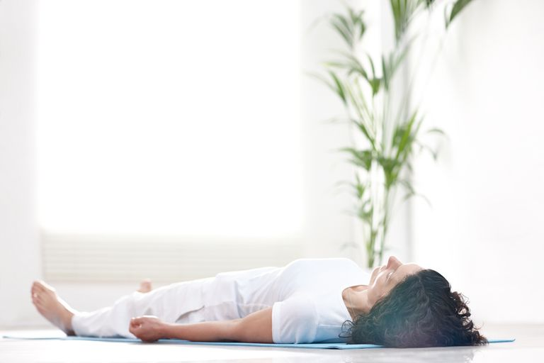 Mature woman doing savasana