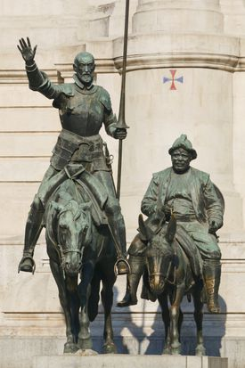 Monuments To Cervantes In Plaza De Espana (Don Quijote Riding His Horse Rocinante And Sancho Panza Riding His Donkey); Madrid Spain