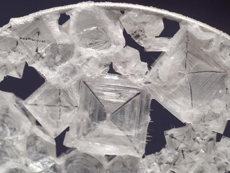 This is a close-up of salt crystals (sodium chloride) in a water bubble on the ISS.