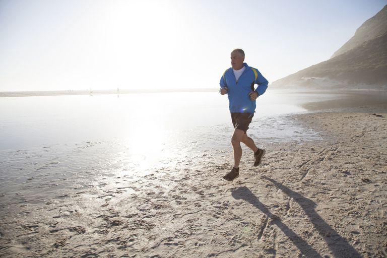 Senior man running on beach