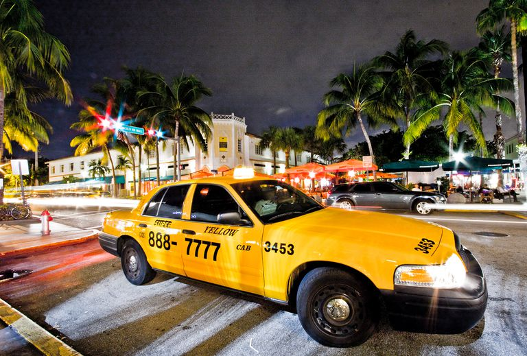 Night Picture of a Yellow Cab parked at Lincoln Road in Miami Beach