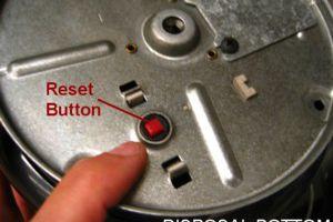 Botón de reinicio del triturador de basura