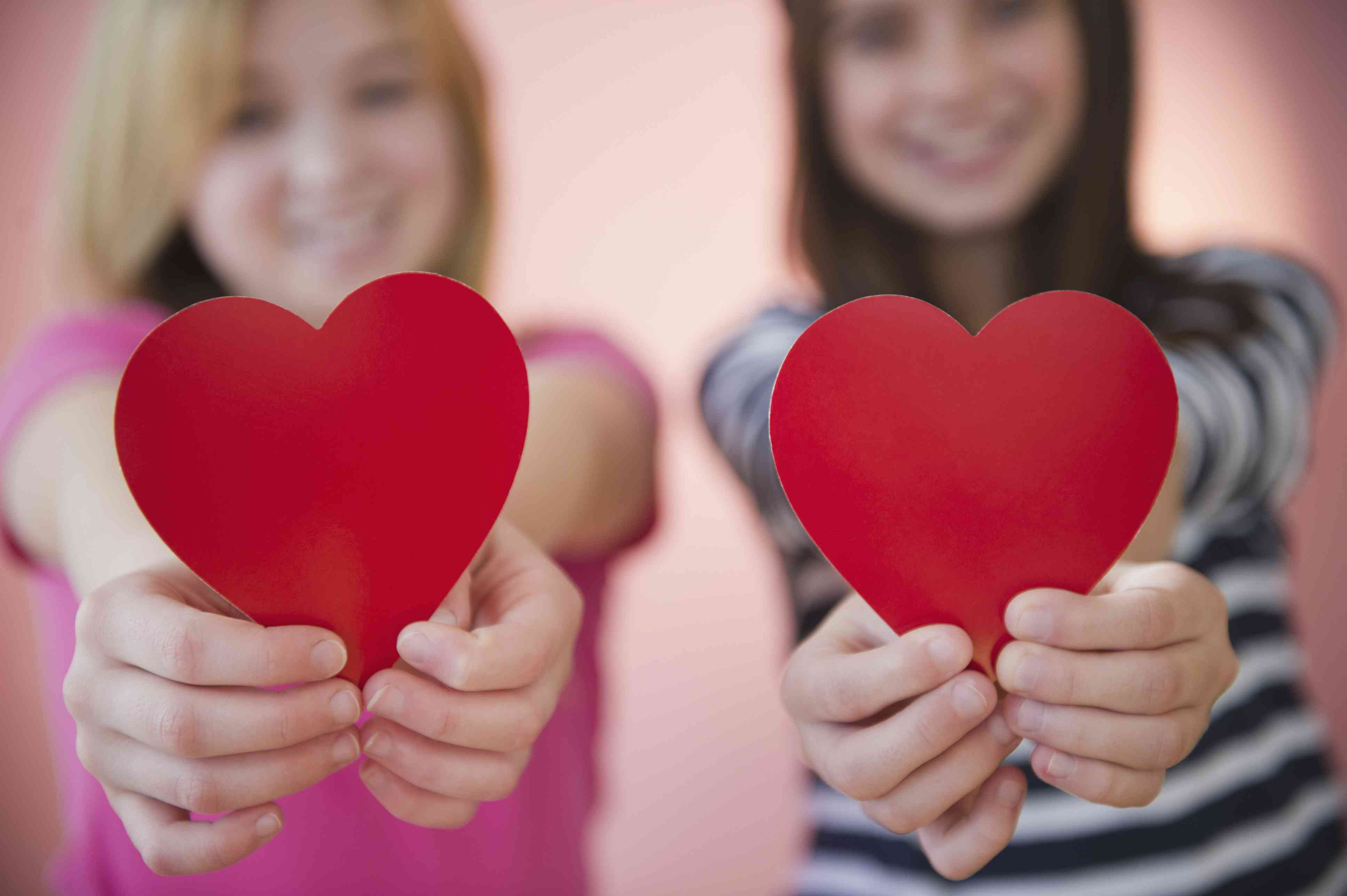 Valentines Day party games - two girls holding matching hearts