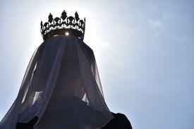 Queen Wearing Crown Against Sky