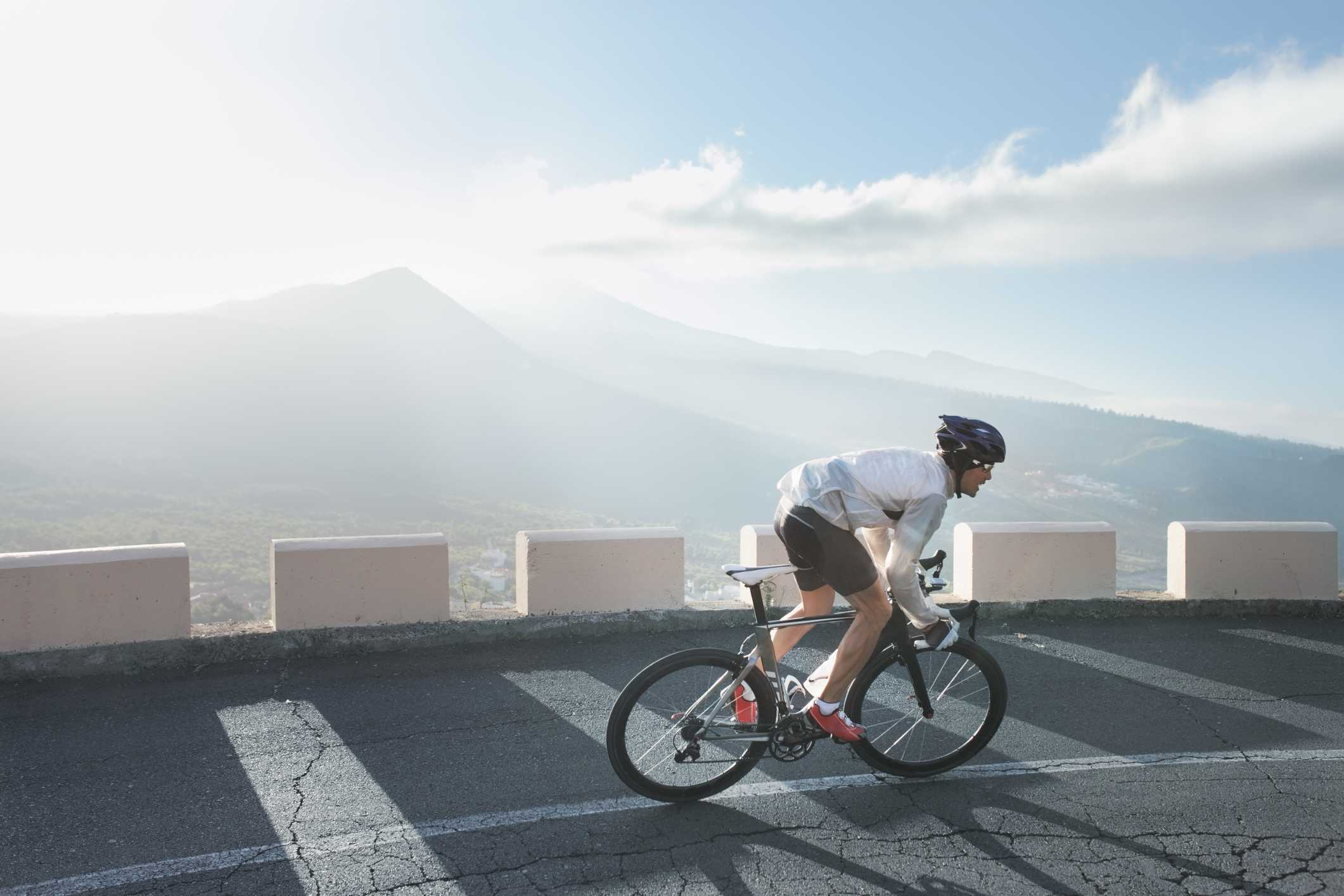 Cyclist riding on mountain road