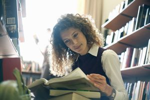 Woman studying book in library