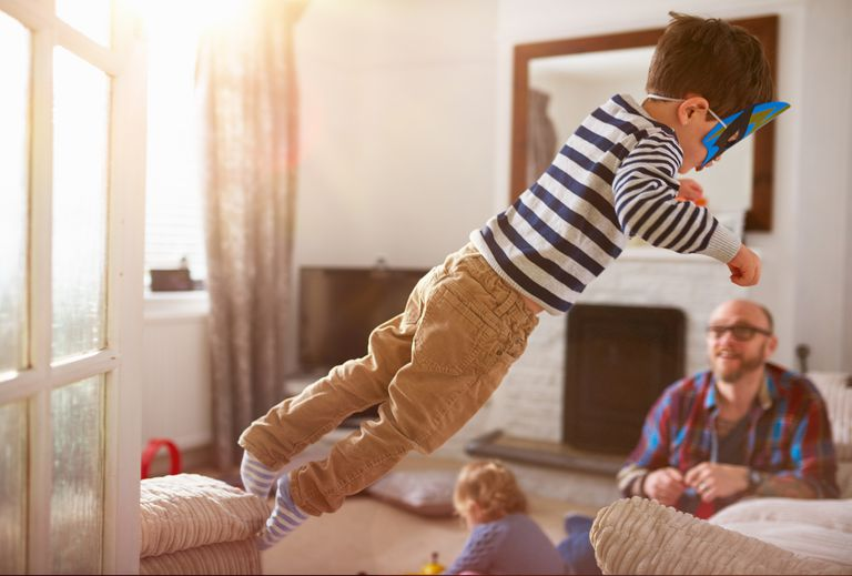 child jumping on sofa