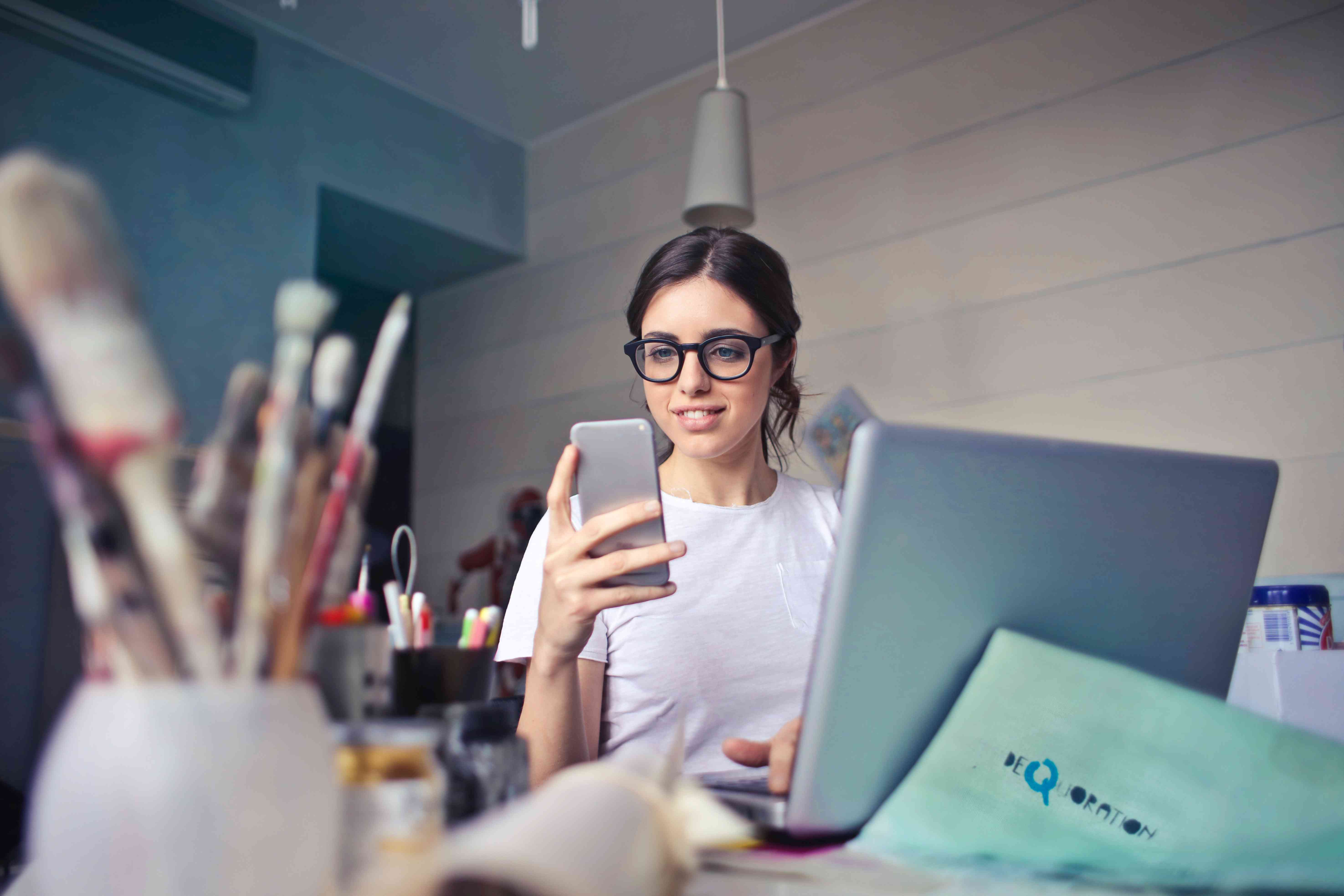 Woman with glasses looking at phone