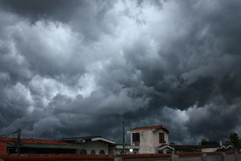 Dark storm clouds over houses in Santa Tecla, El Salvador.