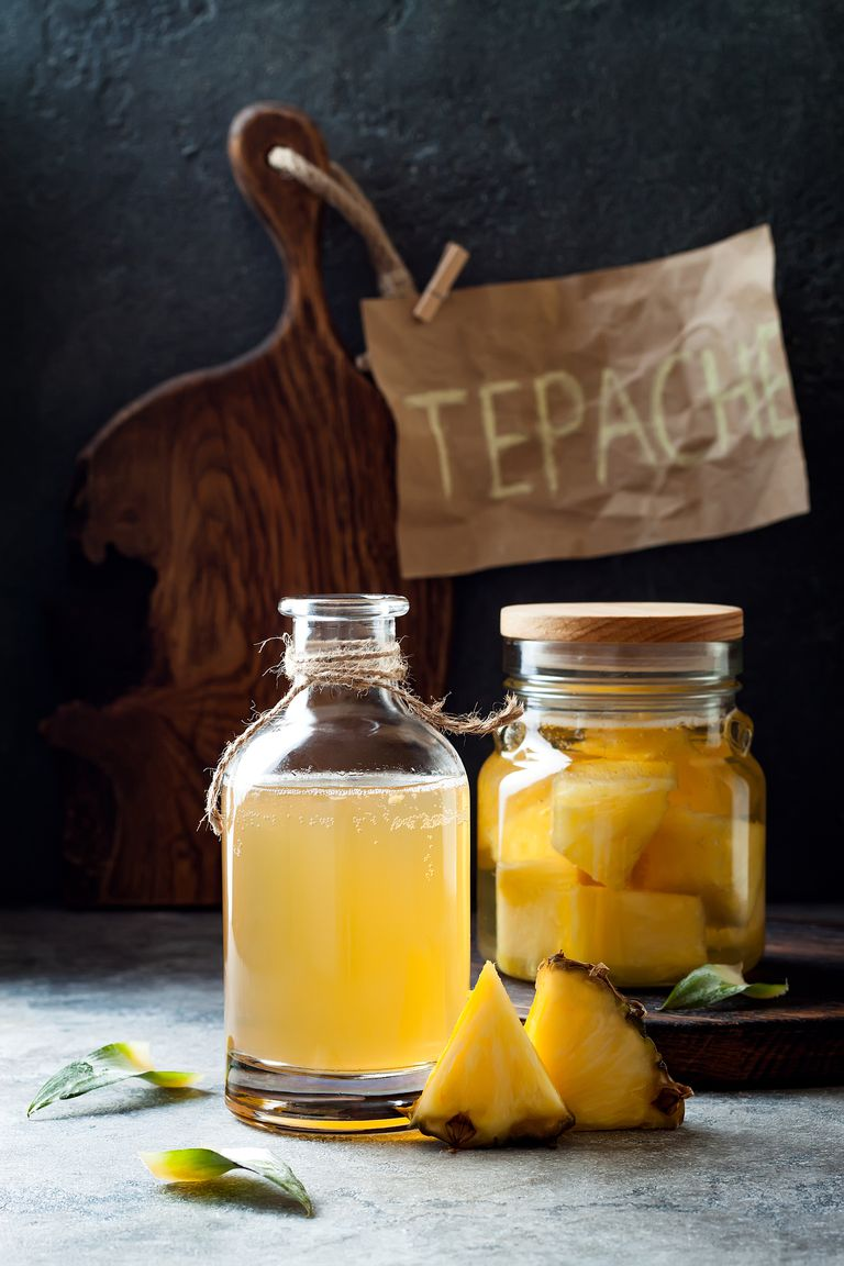 A display of jarred pineapple tepache